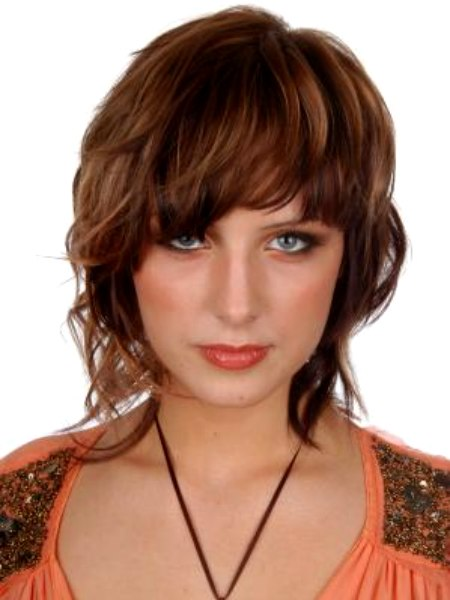 Long layered hairstyle with wispy locks at the neck and a fringe