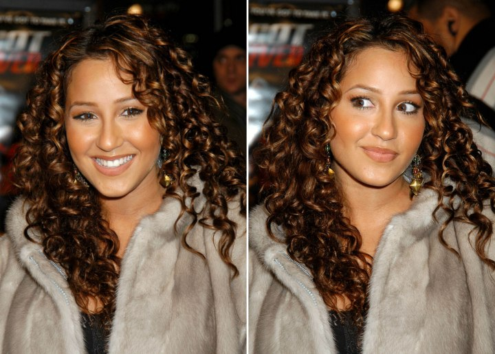 Adrienne Bailon with spiral curls covering the shoulders