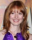 Alicia Witt with long red hair