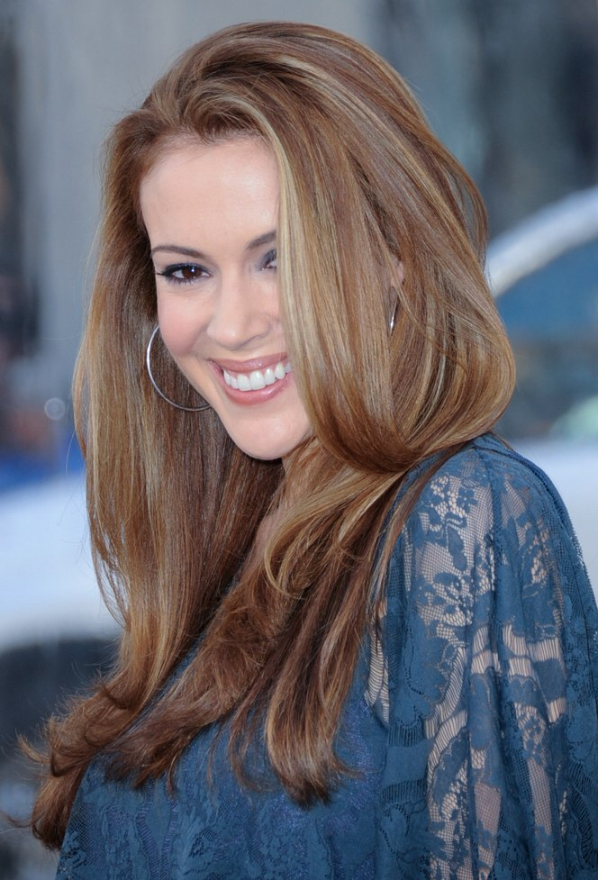 Alyssa Milano Wearing Her Long Hair Smoothed And Below Her Shoulders