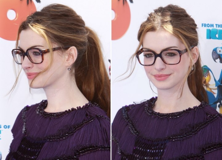 Anne Hathaway Wearing Large Glasses And With Her Hair In A