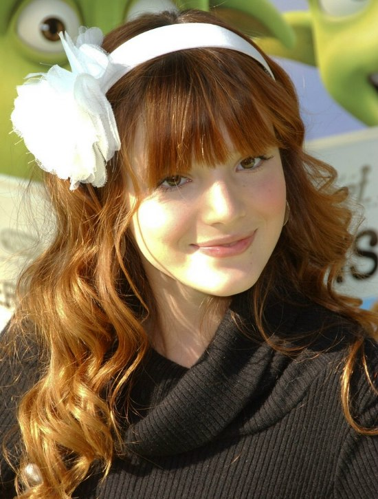 bella thorne wearing long red hair with wavy coils and a
