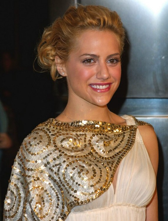 Brittany Murphy Wearing Her Hair In An Up Do With A Curly Bun