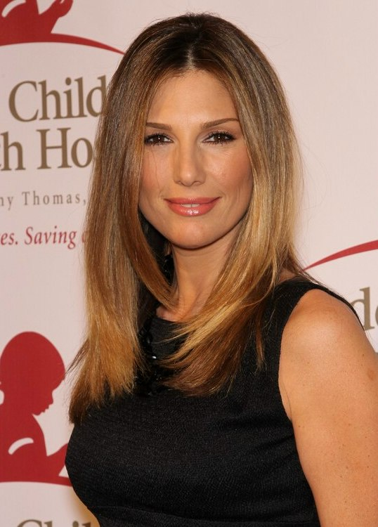 daisy fuentes with long smooth hair that is divided into