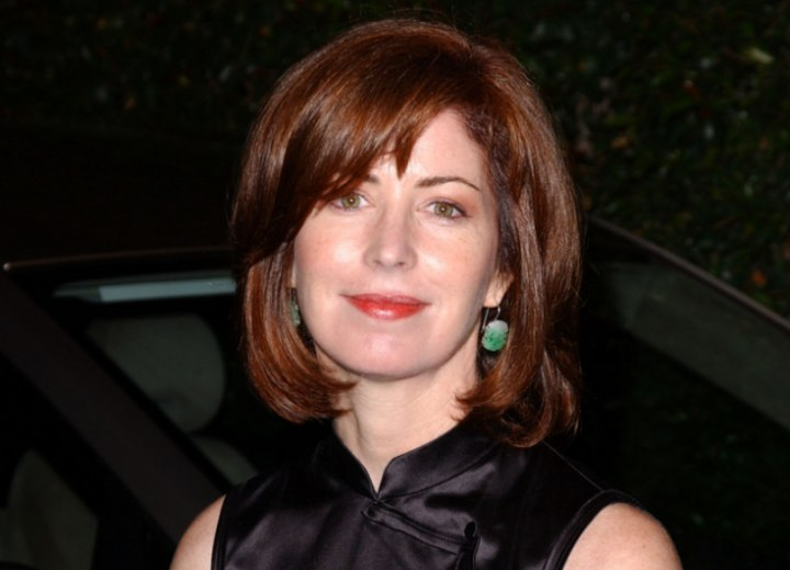 Previous Dana Delany with a medium long hairstyle