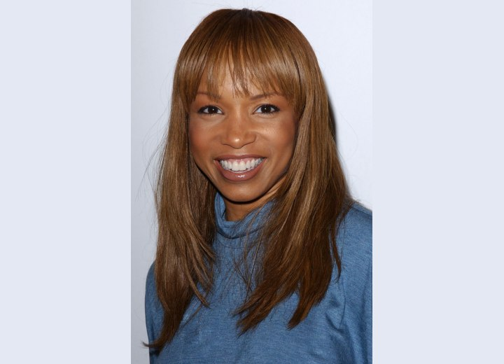 Simple Fix Hairstyle. Elise Neal with a simple fix long hairdo