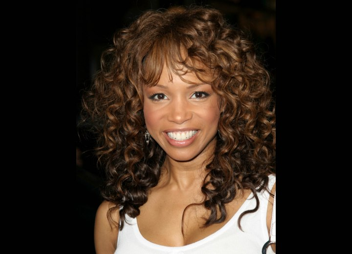 Spiral Perm, Rollers or Curling Iron. Elise Neal with coiled hair