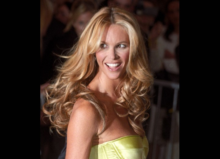 Elle MacPherson | Long middle of the back hairstyle with