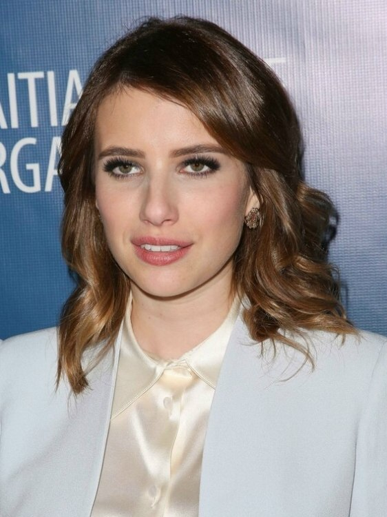 Emma Roberts With Long Wavy Hair And Wearing A Shimmering