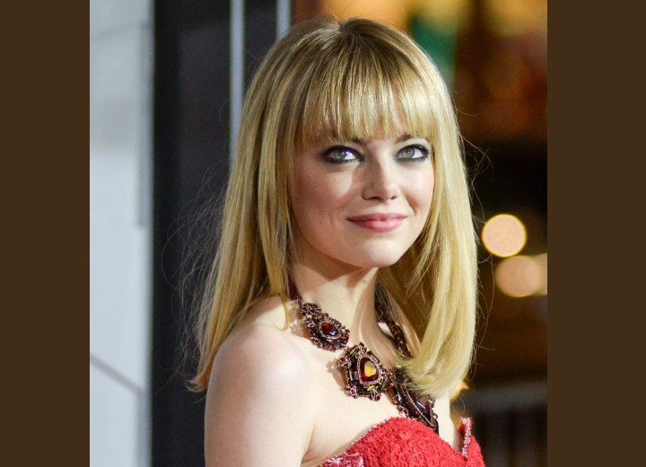 Emma Stone With Her Long Blonde Hair Styled Straight With