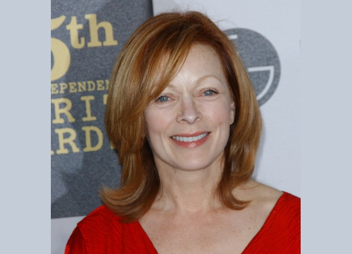 Frances Fisher Shoulder Length Hairstyle With Side Bangs For 50 Women With An Oval Face