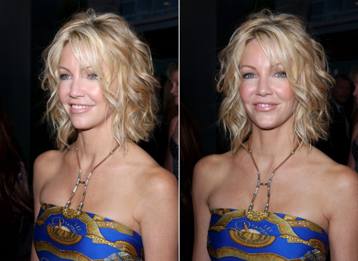 Heather Locklear with her hair cut into a one length bob, disheveled for a