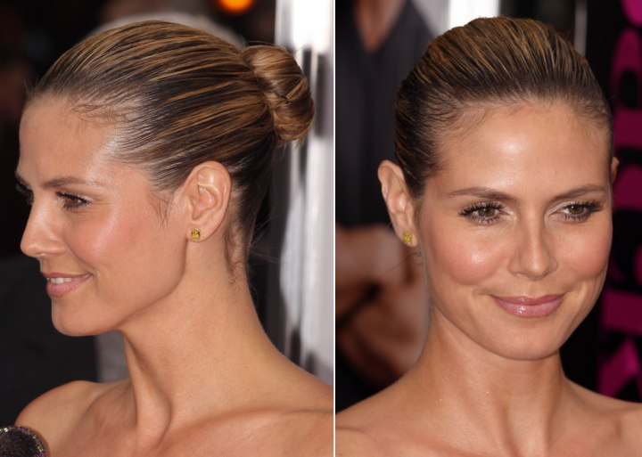 Heidi Klum with her hair severely pulled back into a ...