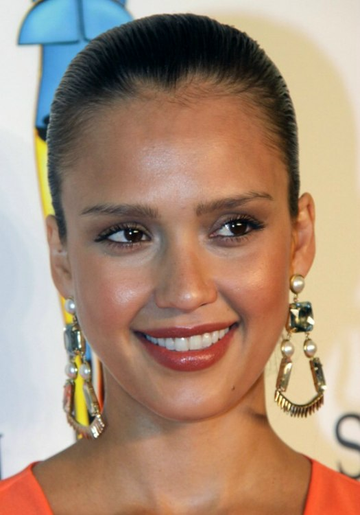 Jessica Alba With Her Hair Styled Tightly And Severely
