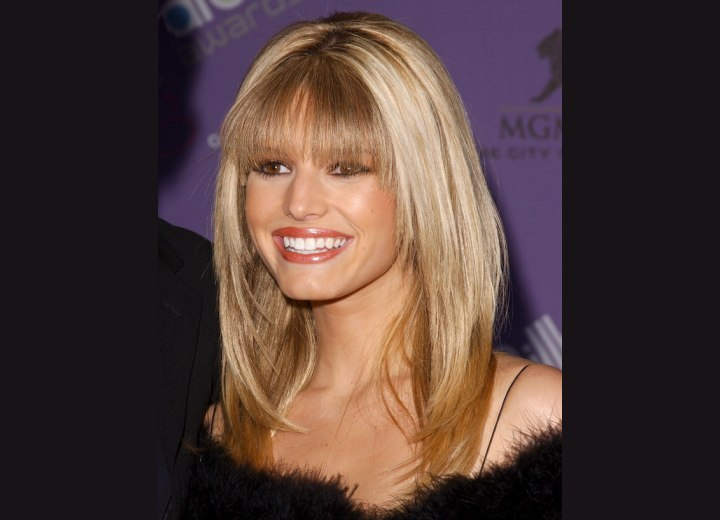jessica simpson hair. Tyra Banks is wearing her hair