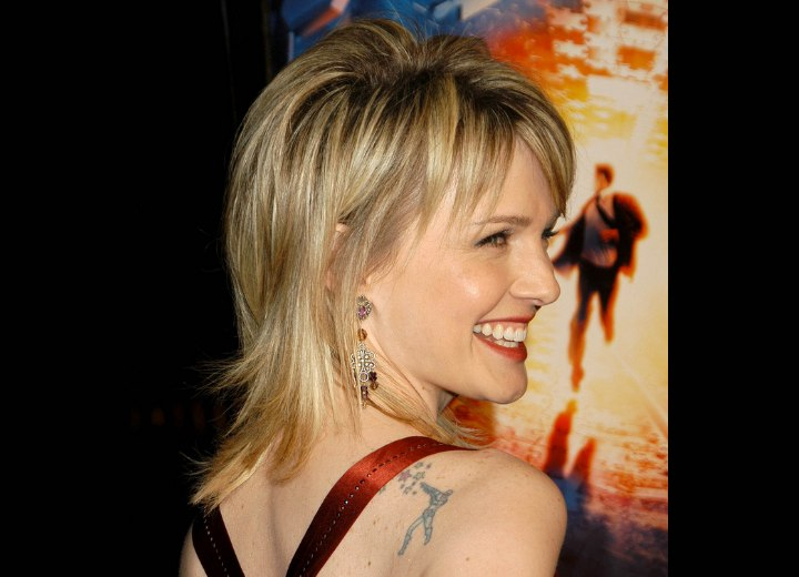 Kathryn Morris Hair Cut In A Classical Shag With Razored Ends