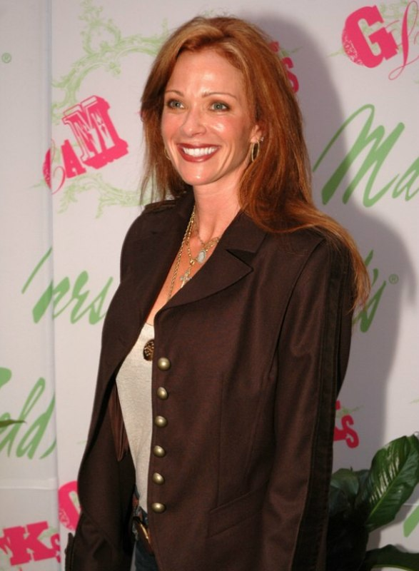 Lauren Holly wearing her long medium red hair in layers
