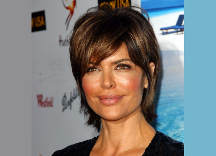 Lisa Rinna sporting a short hairstyle with hair that covers the neck
