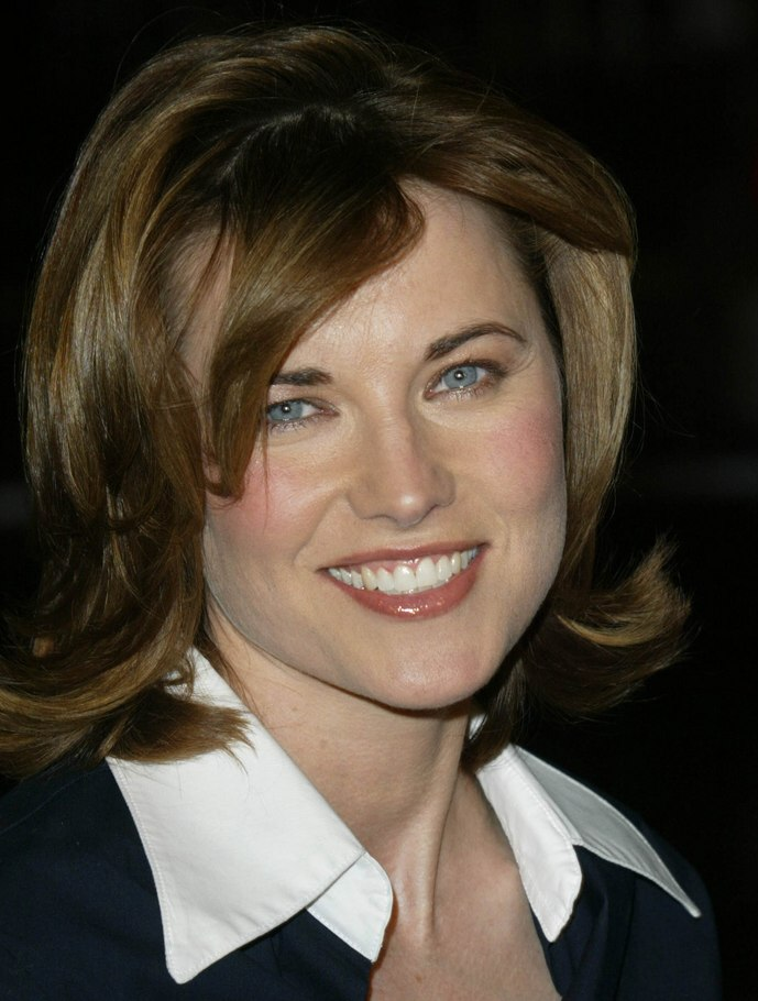 Lucy Lawless Medium Long Wavy Out Of The Face Hairstyle
