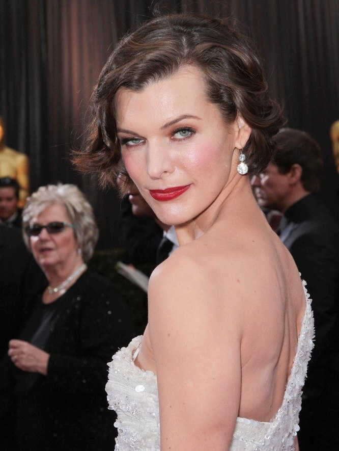 Milla Jovovich With Her Short Hair Styled For A Retro Look
