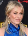 Natasha Bedingfield with semi up-do and shiny silk dress