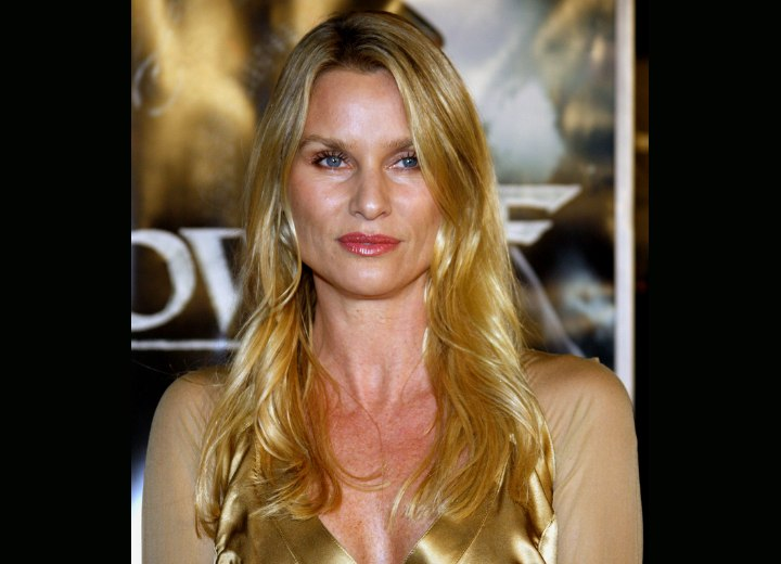 Golden Blonde Hair. Nicollette Sheridan wearing a shiny gold dress
