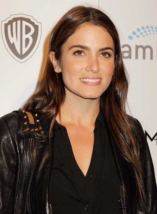 Nikki Reed With Very Long Hair Tucked Behind Both Ears