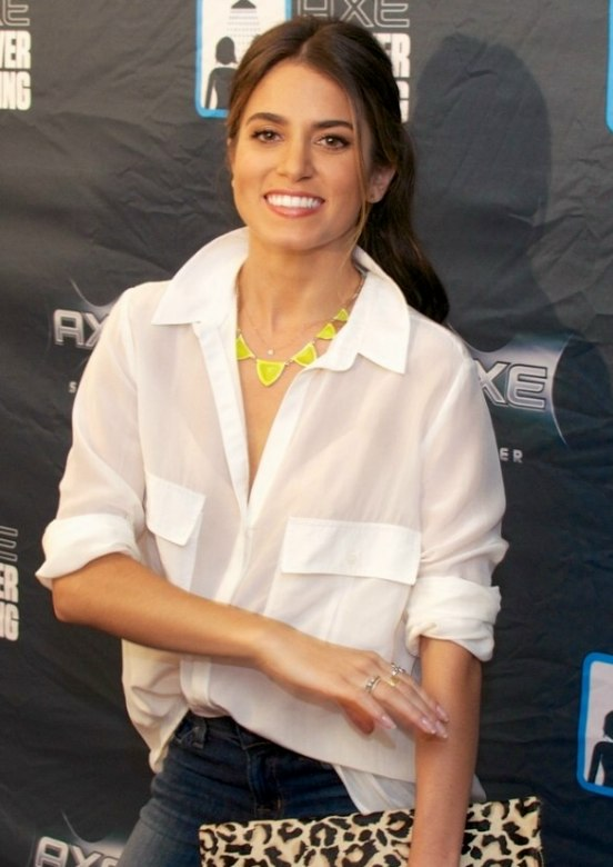 Nikki Reed Wearing Her Hair In A Long Curly Ponytail