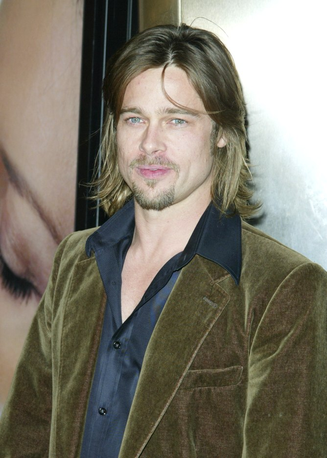 brad pitt with a midlength razor textured shag hairstyle