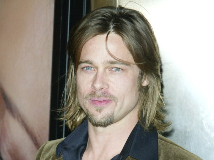 brad pitt fight club hair. Brad Pitt with a mid-length razor textured shag hairstyle