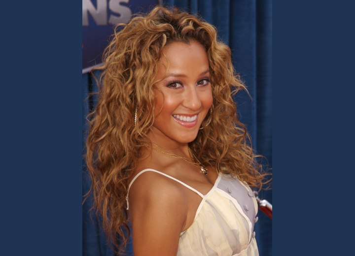 Adrienne Bailon with long curly hair
