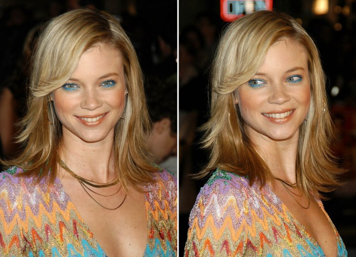 Amy Smart with a blonde jagged hairstyle