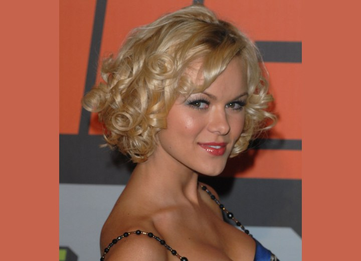 Anya Monzikova with her short hair styled into spiral curls