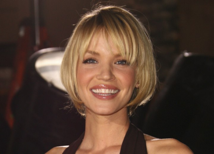 Ashley Scott sporting a short hairstyle that covers her ears