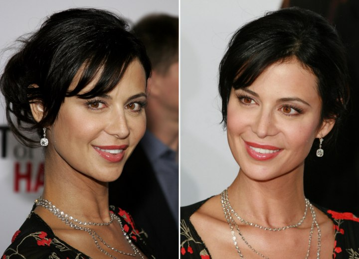 Catherine Bell With Her Hair Pulled Back And Styled Up Into
