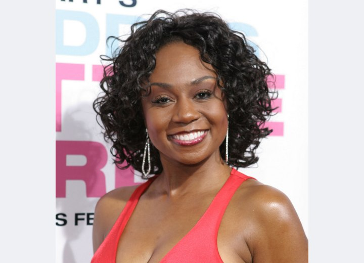 Chantell D. Christopher - Neck length curly hairstyle