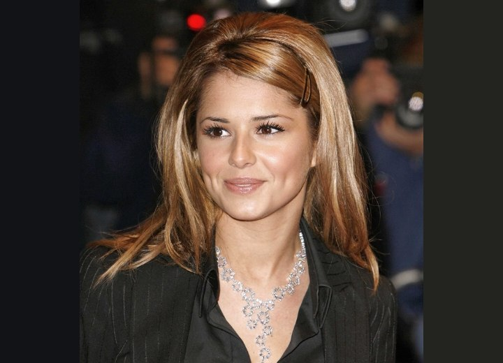 Cheryl Cole with long hair pulled behind her schoulders