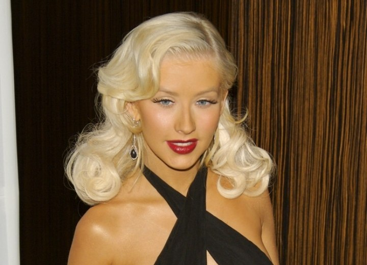 Christina Aguilera with her hair styled for a fifties or sixties look