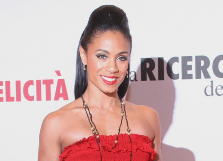 Jada Pinkett Smith wearing her hair in a smooth updo