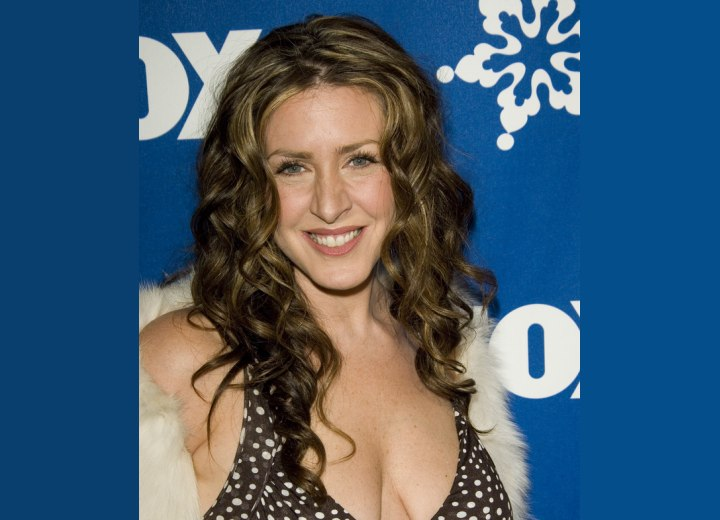Joely Fisher's long hair with waves