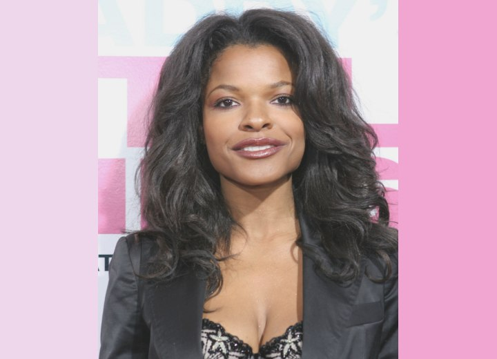 Keesha Sharp with long curled hair
