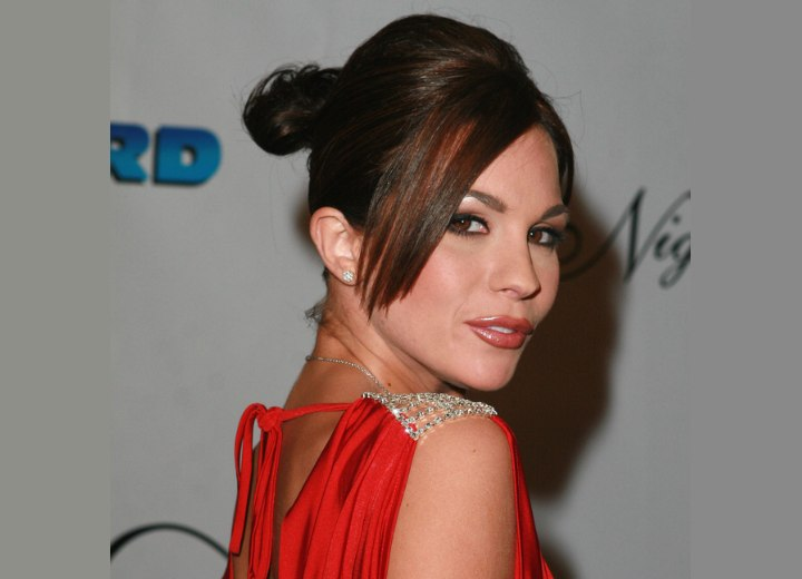 Kirsten Price's updo with hair hanging along side her face