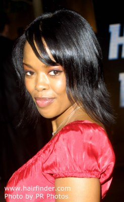 Malinda Williams with a midlength shag haircut