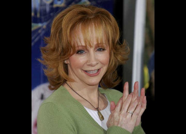 Reba McEntire - Hairstyle with flipped out ends