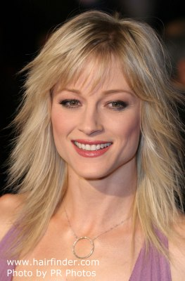 Teri Polo with long jagged hair