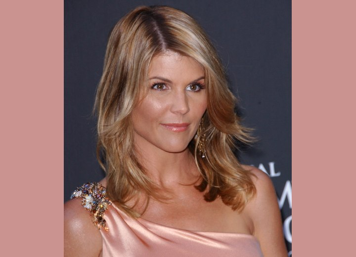 Lori Loughlin S Windswept Hair That Nestles Closely Around