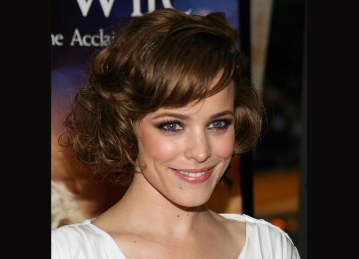 Carla Gugino's Hairstyle With Curled Bangs And Rachel
