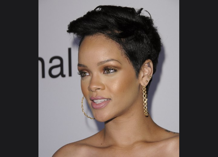 Photo of Rihanna with very short hair. Rihanna's coal back hair condenses