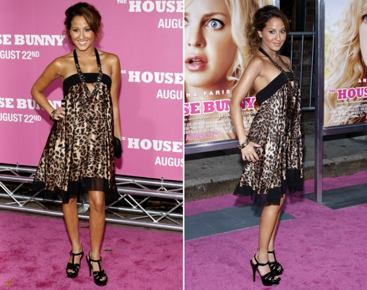 Adrienne Bailon wearing a dress with a leopard print
