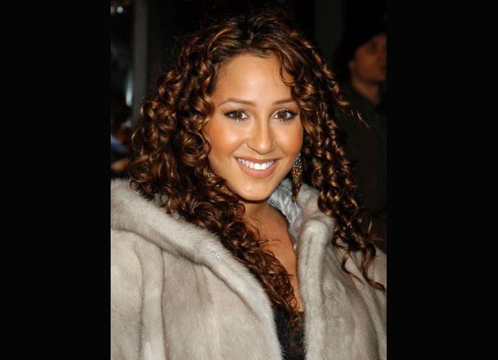 Adrienne Bailon with her hair in spirals